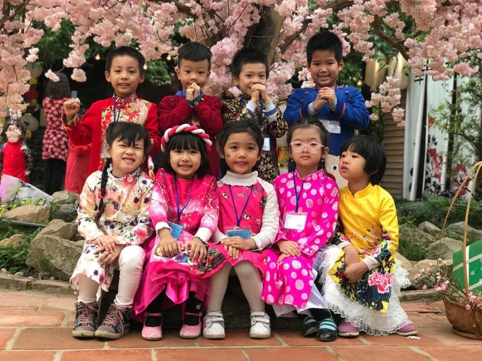 may áo dài trẻ em